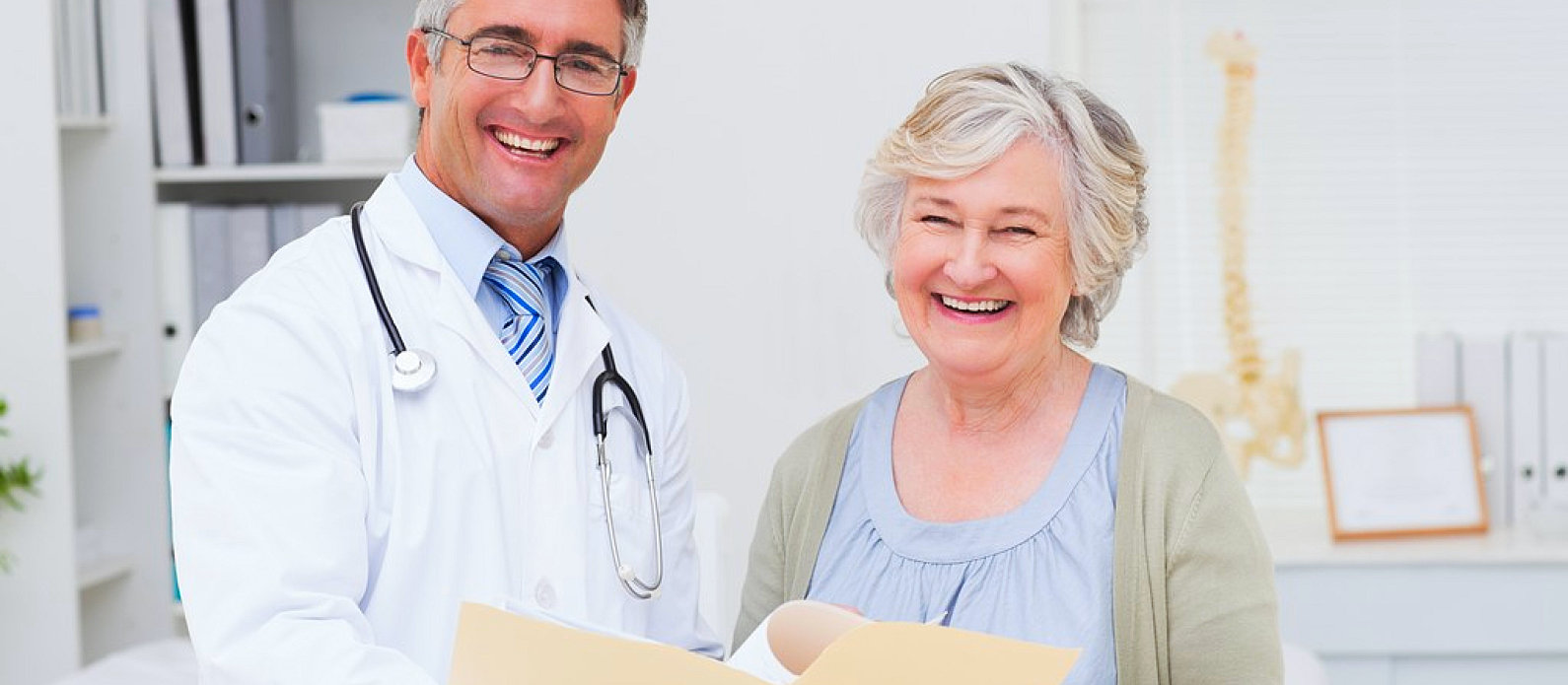 a male doctor and a female patient smiling